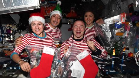(From left) Meir, Parmitano, Morgan and Koch are celebrating Christmas in space - in matching pajamas.