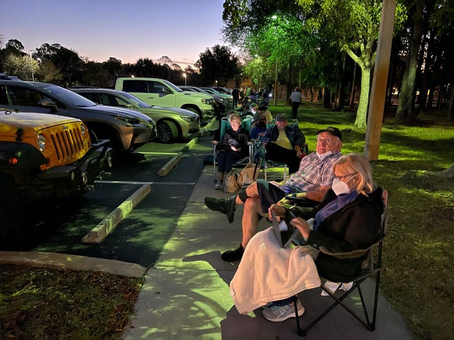 """Mark and Mary Raviz of Cape Coral were the first to line up at Estero Park and Rec Center off Corkscrew Road on Sunday shortly after the announcement of the distribution of 300 doses of Moderna COVID-19 vaccine Monday at 2 p.m. """"I really need this vaccine,"""" Said Mary Raviz, 69.  The couple arrived at the site at 7 pm on a Sunday."""