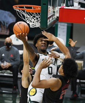 Aaron Henry from Michigan State fighting under the basket in the first half.  Henry finished on 20 points in MSU's 68-45 win over Rutgers on Tuesday.